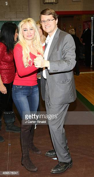 Andrea Catsimatidis and Christopher Nixon Cox attends CitySightseeing New York 2013 holiday toy drive at PAL's Harlem Center on December 14 2013 in...