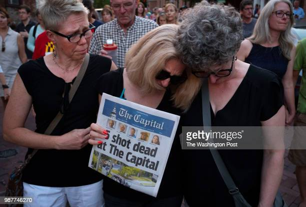 Andrea Chamblee wife of shooting victim and reporter John McNamara marches in the vigil held in downtown Annapolis Maryland to honor the lives lost...