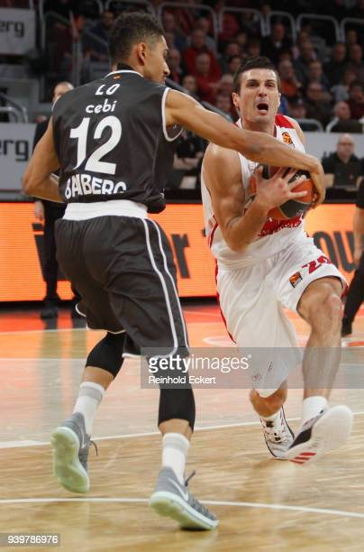 Andrea Cianciarini #20 of AX Armani Exchange Olimpia Milan competes with Maodo Lo #12 of Brose Bamberg in action during the 2017/2018 Turkish...