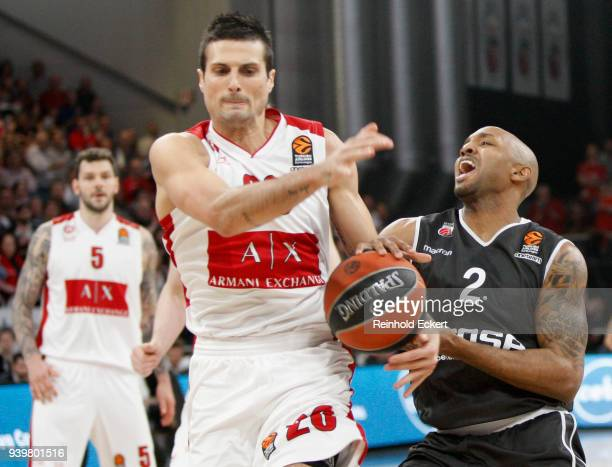 Andrea Cianciarini #20 of AX Armani Exchange Olimpia Milan competes with Ricky Hickman #2 of Brose Bamberg in action during the 2017/2018 Turkish...