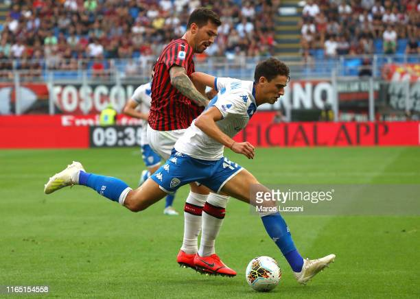 Andrea Cistana of Brescia Calcio competes for the ball with Alessio Romagnoli of AC Milan during the Serie A match between AC Milan and Brescia...