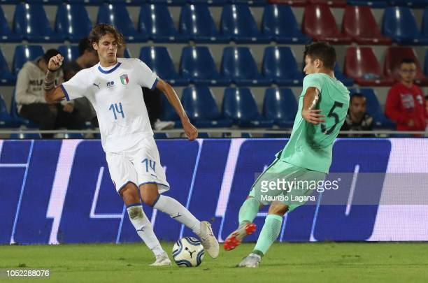 Andrea Colpani of Italy competes for the ball with Moura of Portugal during the match beteween Italy U20 v Portugal U20 on October 16 2018 in Crotone...