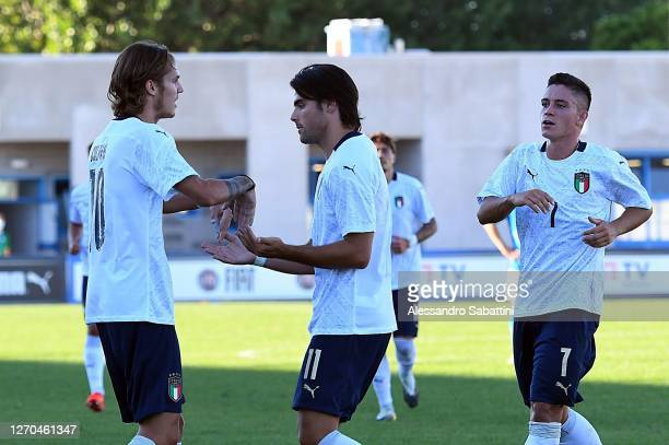 Andrea Colpani of Italy U21 celebrates with teammates after scoring the opening goal during the International Friendly match between Italy U21 and...
