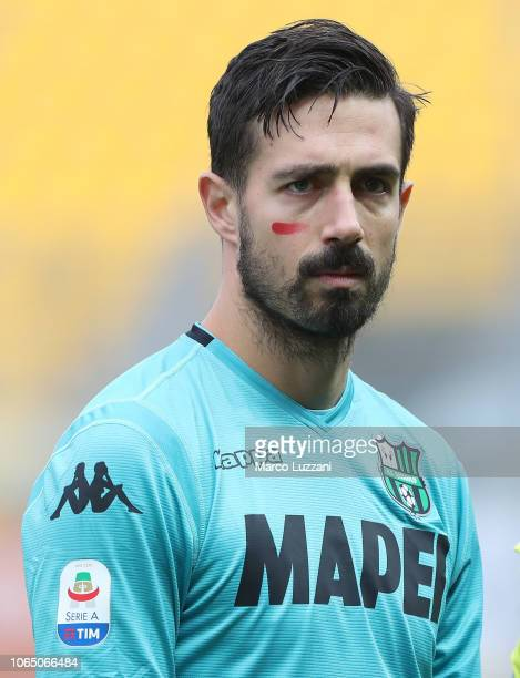 Andrea Consigli of US Sassuolo show the red mark on the face to support the campaign Un Rosso Alla Violenza before the Serie A match between Parma...