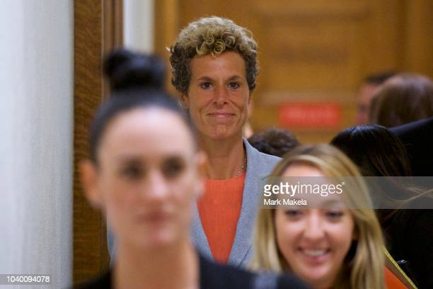 Andrea Constant reacts after Bill Cosby was sentenced to 310 years in the assault retrial at the Montgomery County Courthouse on September 25 2018 in...