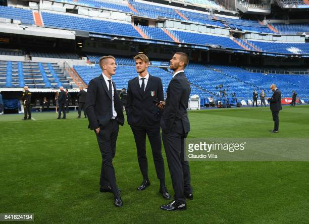 Andrea Conti Daniele Rugani and Leonardo Spinazzola of Italy chat at Estadio Santiago Bernabeu on September 1 2017 in Madrid Spain