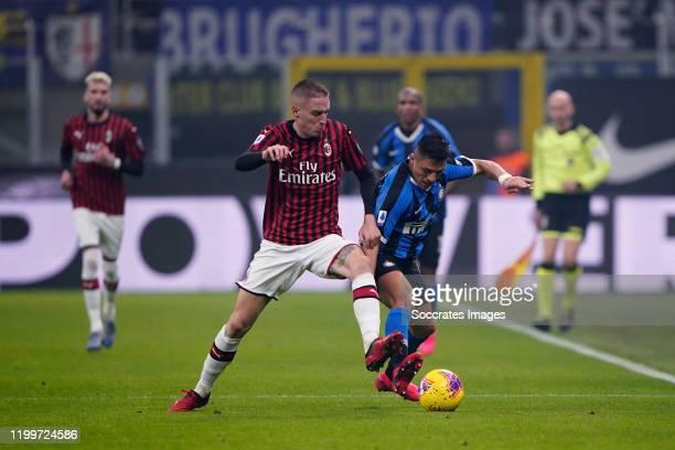 Andrea Conti of AC Milan Alexis Sanchez of FC Internazionale Milano during the Italian Serie A match between Internazionale v AC Milan at the San...