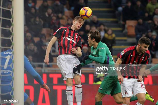 Andrea Conti of AC Milan competes for the ball with Federico Chiesa of ACF Fiorentina during the serie A match between AC Milan and ACF Fiorentina at...
