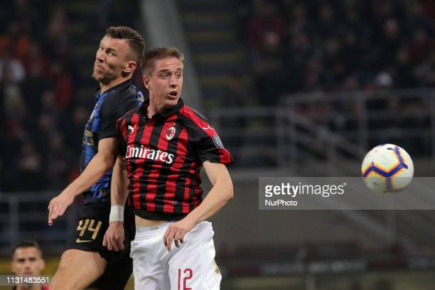 Andrea Conti of AC Milan competes for the ball with Ivan Perisic of FC Internazionale Milano during the serie A match between AC Milan and FC...