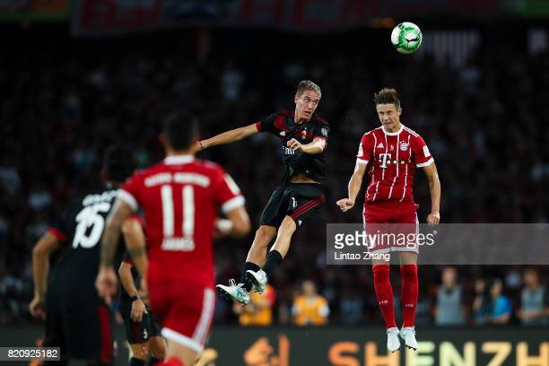 Andrea Conti of AC Milan competes for the ball with Marco Friedl of FC Bayern during the 2017 International Champions Cup China match between FC...
