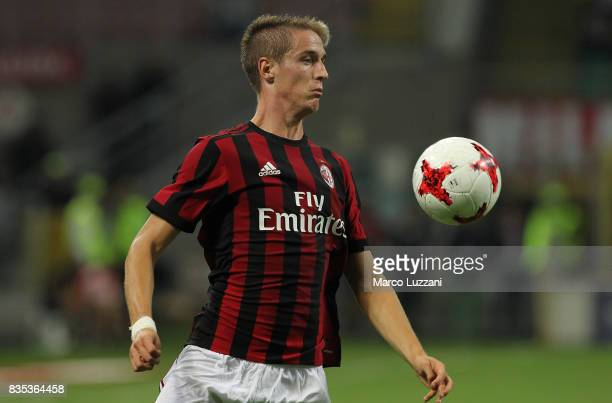 Andrea Conti of AC Milan controls the ball during the UEFA Europa League Qualifying PlayOffs round first leg match between AC Milan and KF Shkendija...