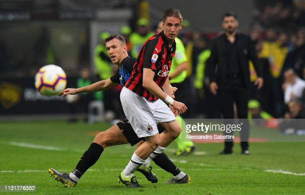 Andrea Conti of AC Milan in action during the Serie A match between AC Milan and FC Internazionale at Stadio Giuseppe Meazza on March 17 2019 in...