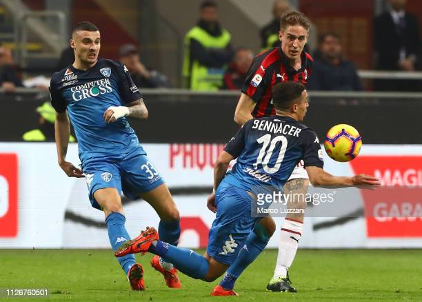 Andrea Conti of AC Milan is challenged by Ismael Bennacer of Empoli during the Serie A match between AC Milan and Empoli at Stadio Giuseppe Meazza on...