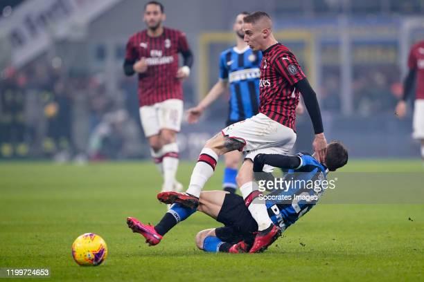Andrea Conti of AC Milan Nicolo Barella of FC Internazionale Milano during the Italian Serie A match between Internazionale v AC Milan at the San...