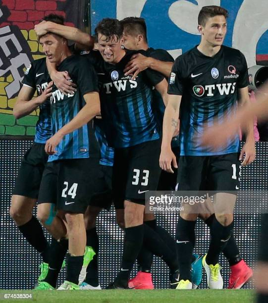 Andrea Conti of Atalanta BC celebrates with his teammates after scoring the opening goal during the Serie A match between Atalanta BC and Juventus FC...