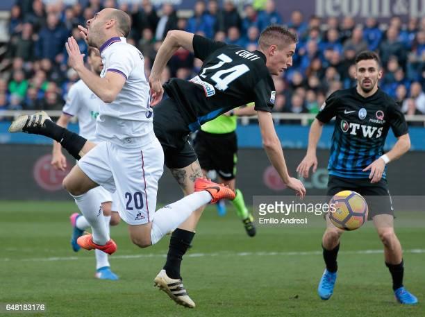 Andrea Conti of Atalanta BC competes for the ball with Borja Valero of ACF Fiorentina during the Serie A match between Atalanta BC and ACF Fiorentina...