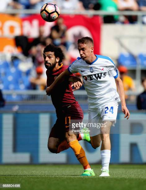 Andrea Conti of Atalanta BC competes for the ball with Mohamed Salah of AS Roma during the Serie A match between AS Roma and Atalanta BC at Stadio...