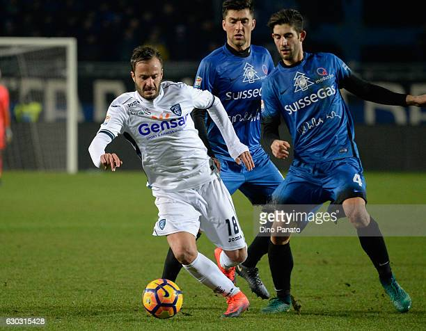 Andrea Conti of Atalanta BC competes with Alberto Gilardino of Empoli FC during the Serie A match between Atalanta BC and Empoli FC at Stadio Atleti...