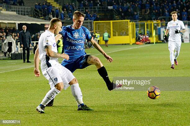 Andrea Conti of Atalanta BC competes with Federico Dimarco of Empoli FC during the Serie A match between Atalanta BC and Empoli FC at Stadio Atleti...