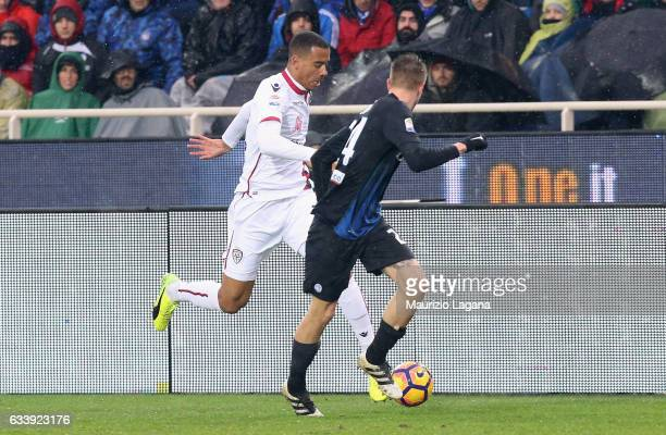 Andrea Conti of Atalanta competes for the ball with senn Miangue of Cagliari during the Serie A match between Atalanta BC and Cagliari Calcio at...