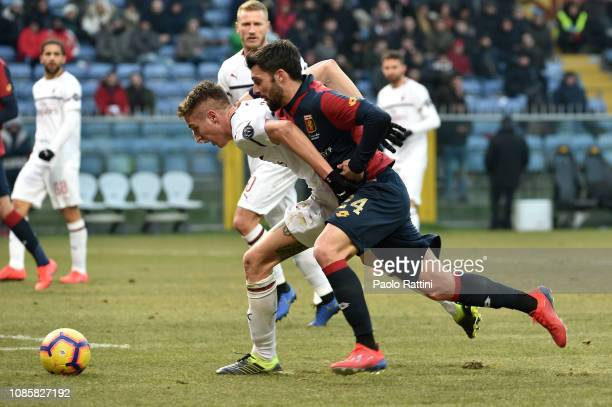 Andrea Conti of Milan and Daniel Bessa of Genoa during the Serie A match between Genoa CFC and AC Milan at Stadio Luigi Ferraris on January 21 2019...