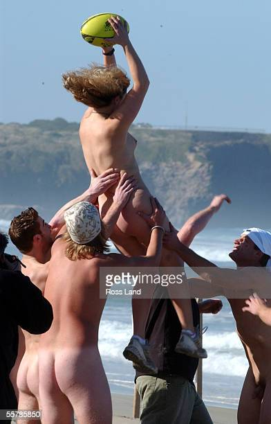Andrea Cooper is lifted in the lineout by her International Barbarians teamates during the nude touch rugby match at St Kilda beach Dunedin Saturday