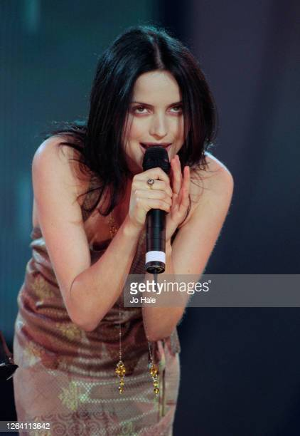 Andrea Corr of The Corrs performs on stage at Netaid Charity Concert for Third World Debt Wembley Stadium London United Kingdom 9 October 1999