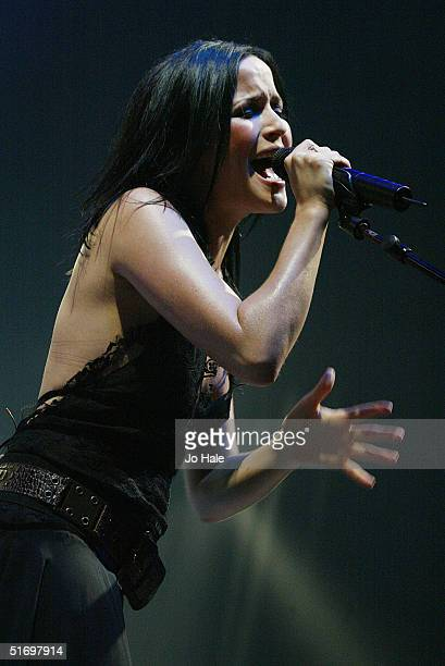 Andrea Corr of The Corrs performs on stage at Wembley Arena on November 8 2004 in London The concert promotes their new album 'Borrowed Heaven'...