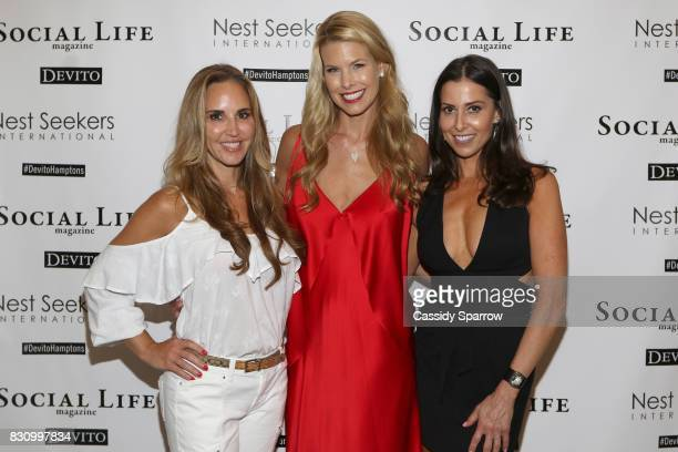 Andrea Correale Beth Stern and Christine Montanti attend the Social Life Magazine Nest Seekers August Issue Party on August 12 2017 in Southampton...