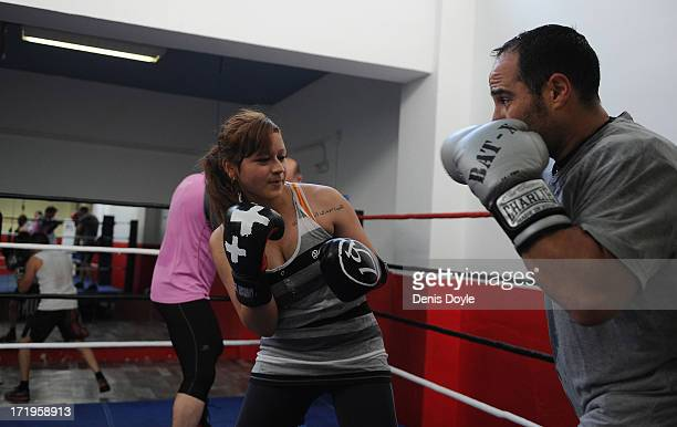 Andrea Cox an 18yearold Bachelor of Arts student spars witha male companion at a boxing gym on June 24 2013 in Madrid Spain Spanish women are...