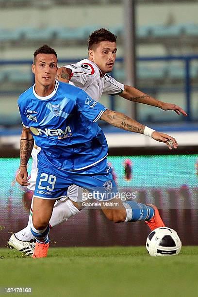 Andrea Cristiano of Empoli FC battles for the ball with Fabio Pisacane of Ternana Calcio during the Serie B match between Empoli FC and Ternana...