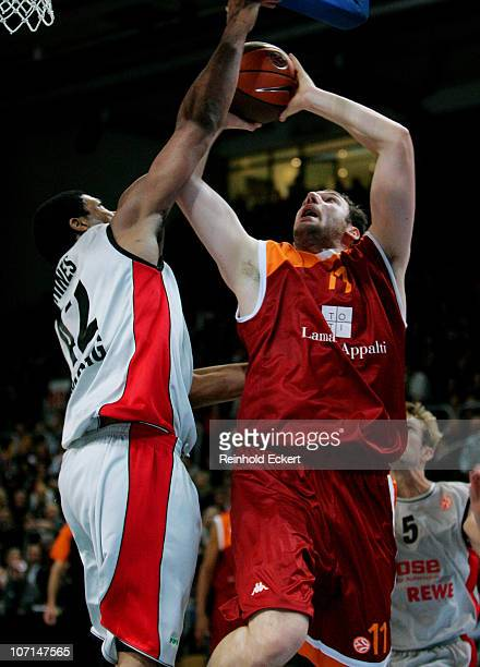 Andrea Crosariol #11 of Lottomatica Roma competes with Kyle Hines #42 of Brose Baskets during the 20102011 Turkish Airlines Euroleague Regular Season...