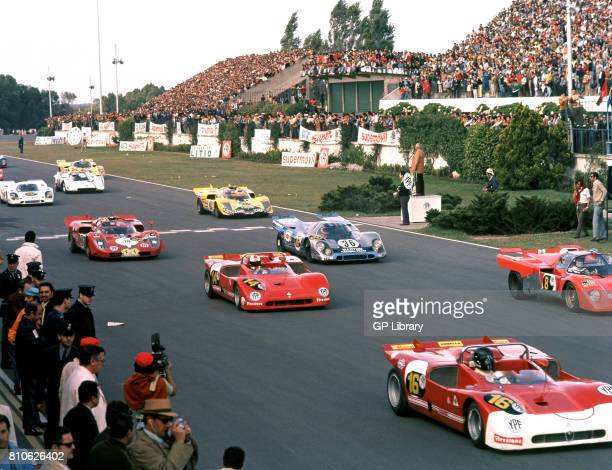 Andrea de Adamich in a Alfa Romeo 4th at Start Buenos Aires and Mike Parkes in a Ferrari 512 M 7th