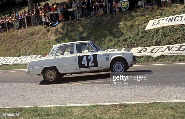 Andrea de AdamichCarlo Scarambone's Alfa Romeo Giulia exiting the Nouveau Monde Hairpin on the RouenlesEssarts road circuit in the Tour De France 20...