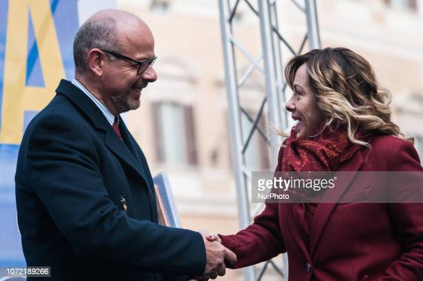 Andrea de Bertoldi senator of Fratelli d'Italia and secretary of the Senate Finance Commission with Giorgia Meloni Fratelli d'Italia Leader speaks...