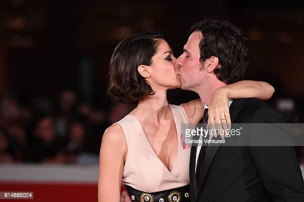 Andrea Delogu and Francesco Montanari walk a red carpet for 'Sole Cuore Amore' during the 11th Rome Film Festival at Auditorium Parco Della Musica on...