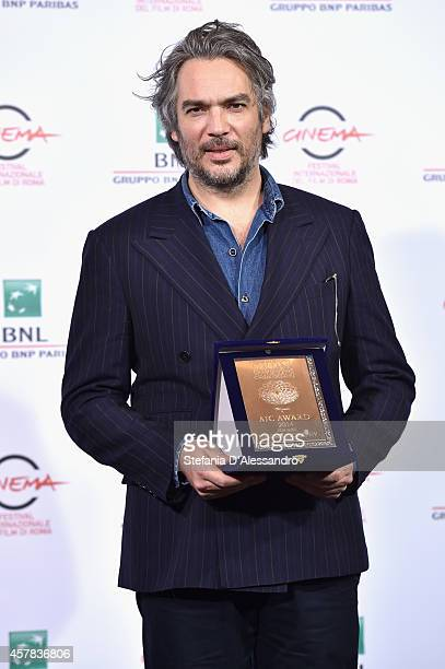Andrea Di Stefano is bestowed with the AIC Award for the Best Photography at the Collateral Awards Photocall during the 9th Rome Film Festival at...