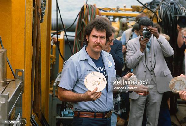 Andrea Doria Project expedition crew member is photographed August 16 1984 at the Brooklyn Aquarium in New York City showing recovered pottery from...