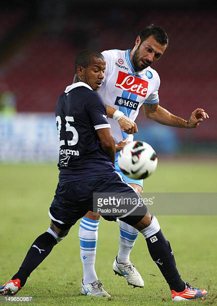 Andrea Dossena of SSC Napoli competes for the ball with Mariano Ferreira Filho of FC Girondins de Bordeaux during the preseason friendly match...