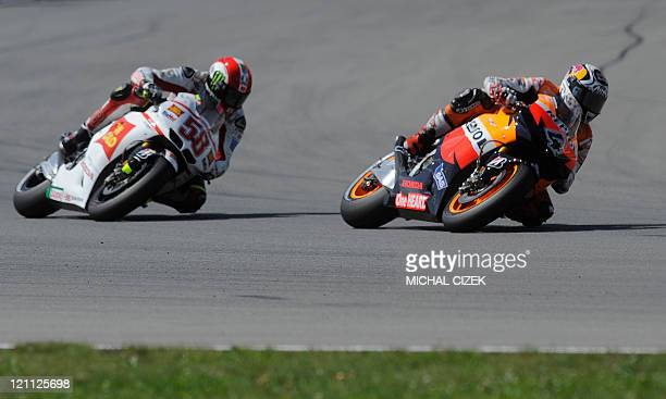 Andrea Dovizioso and Marco Simoncelli both of Italy compete during Czech Republic's Moto GP Grand Prix on August 14 2011 in Brno Dovizioso and...