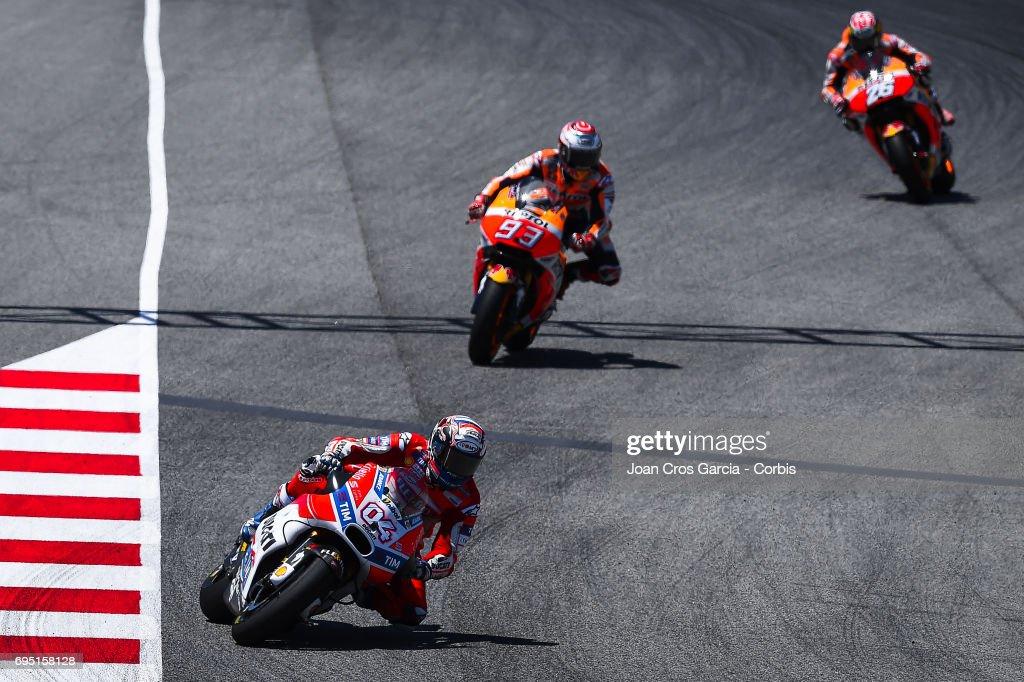 Andrea Dovizioso of Ducati Team and Dani Pedrosa and Marc Marquez of Repsol Honda Team, riding his bikes during the Moto GP race, Moto GP of Catalunya at Circuit de Catalunya on June 11, 2017 in Montmelo, Spain.