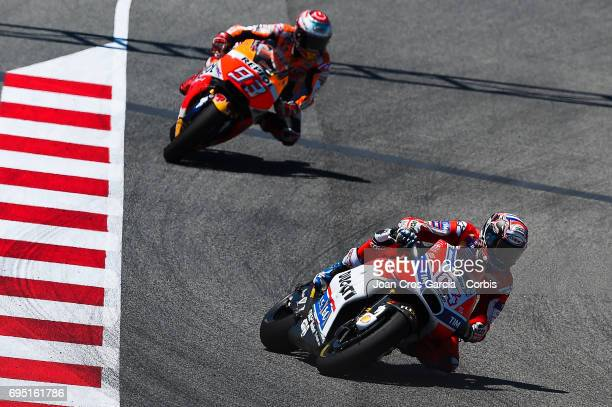 Andrea Dovizioso of Ducati Team and Marc Marquez of Repsol Honda Team riding his bikes during the Moto GP race Moto GP of Catalunya at Circuit de...