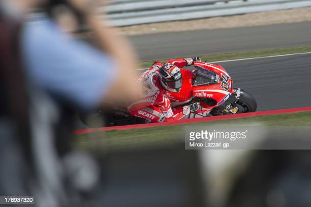Andrea Dovizioso of Italy and Ducati Marlboro Team round sthe bend during the MotoGp Of Great Britain Qualifying at Silverstone Circuit on August 31...