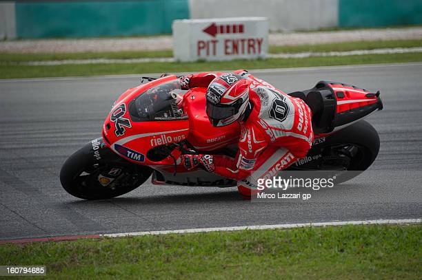 Andrea Dovizioso of Italy and Ducati Marlboro Team rounds the bend during the MotoGP Tests in Sepang Day Four at Sepang Circuit on February 6 2013 in...