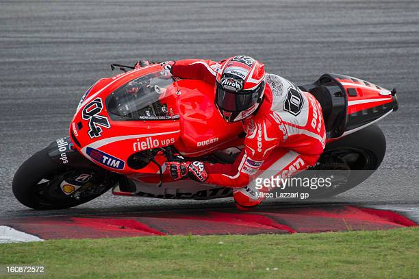 Andrea Dovizioso of Italy and Ducati Marlboro Team rounds the bend during the MotoGP Tests in Sepang Day Five at Sepang Circuit on February 7 2013 in...