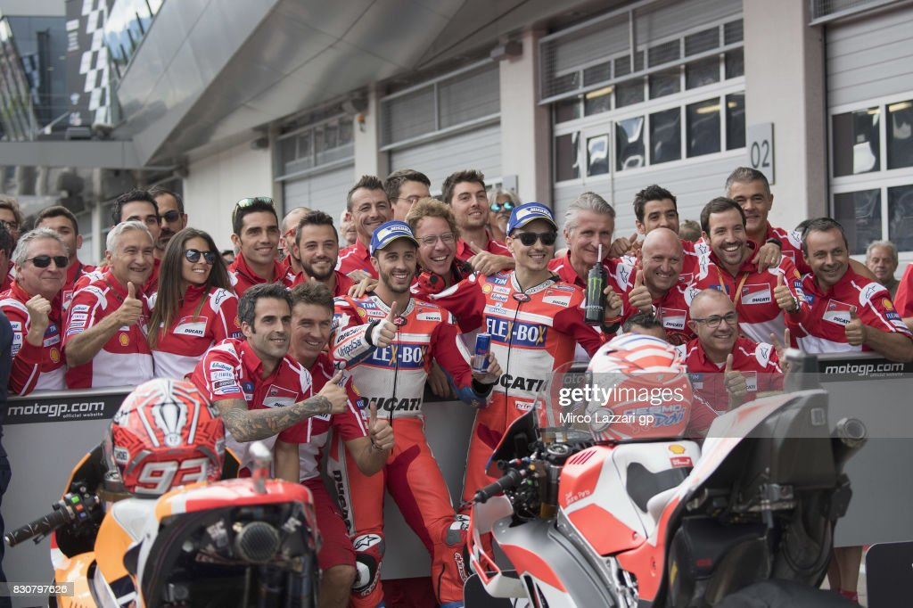 Andrea Dovizioso of Italy and Ducati Team and Jorge Lorenzo of Spain and Ducati Team celebrate with team at the end of the qualifying practice during the MotoGp of Austria - Qualifying at Red Bull Ring on August 12, 2017 in Spielberg, Austria.