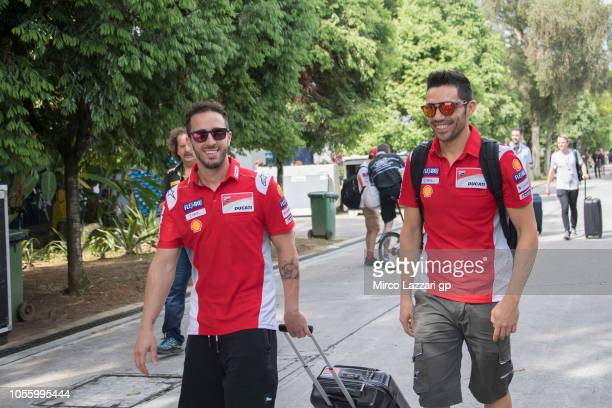Andrea Dovizioso of Italy and Ducati Team and Michele Pirro of Italy and Ducati Team arrive in paddock during the MotoGP Of Malaysia Previews at...