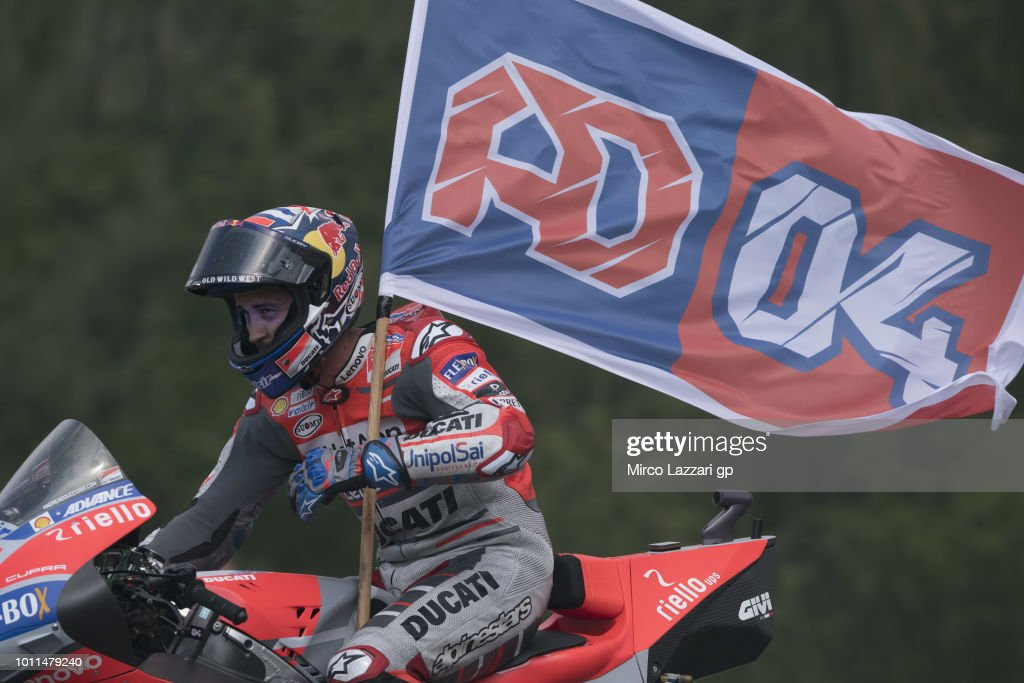 Andrea Dovizioso of Italy and Ducati Team celebrates the MotoGP victory with flag at the end of the MotoGP Race during the MotoGp of Czech Republic - Race at Brno Circuit on August 5, 2018 in Brno, Czech Republic.