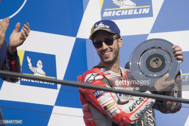 Andrea Dovizioso of Italy and Ducati Team celebrates the second place on the podium at the end of the MotoGP race during the MotoGP of Australia Race...