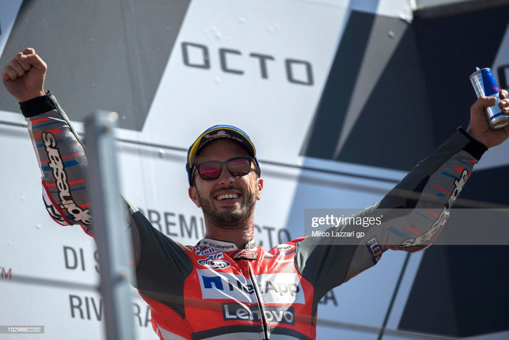 Andrea Dovizioso of Italy and Ducati Team celebrates the victory on the podium at the end of the MotoGP race during the MotoGP of San Marino - Race at Misano World Circuit on September 9, 2018 in Misano Adriatico, Italy.